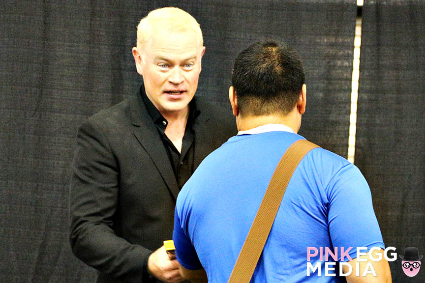 Neal McDonough with a fan.