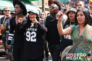 Janelle Monae, local artists, activist, families, and community participants marching in San Francisco's Mission District.