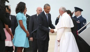 President Barack Obama and first lady Michelle Obama greet Pope Francis upon his arrival at Andrews Air Force Base, Md., Tuesday, Sept. 22, 2015. Andrew Harnik / AP