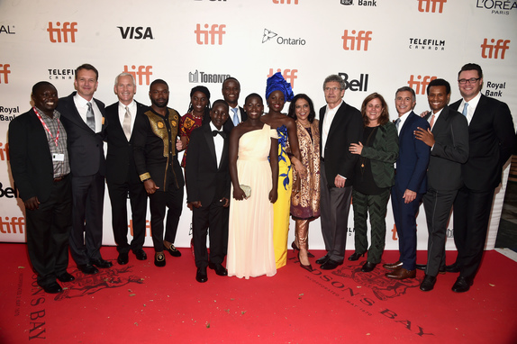 "(L-R) Mark Mugwana, President of Walt Disney Studios Motion Picture Production, Sean Bailey, producer John Carls, actor David Oyelowo, Ugandan national chess champion Phiona Mutesi, actor Martin Kabanza, Chess Coach and Director of Sports Outreach in Uganda, Robert Katende, actors Madina Nalwanga, Lupita Nyong'o, director Mira Nair, Chairman, The Walt Disney Studios, Alan Horn, producer Lydia Pilcher, President, Marketing, The Walt Disney Studios, Ricky Strauss, Executive Vice President of Production, The Walt Disney Studios, Tendo Nagenda and EVP, Distribution at The Walt Disney Company, Dave Hollis arrive at the world premiere of Disney's ""Queen of Katwe"" at Roy Thompson Hall"