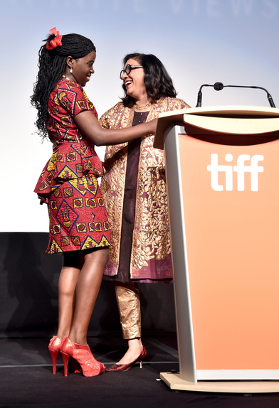 "Ugandan national chess champion Phiona Mutesi (L) and director Mira Nair onstage at the world premiere of Disney's ""Queen of Katwe"" at Roy Thompson Hall"