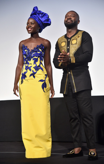 "Actors Lupita Nyong'o (L) and David Oyelowo onstage at the world premiere of Disney's ""Queen of Katwe"" at Roy Thompson Hall"