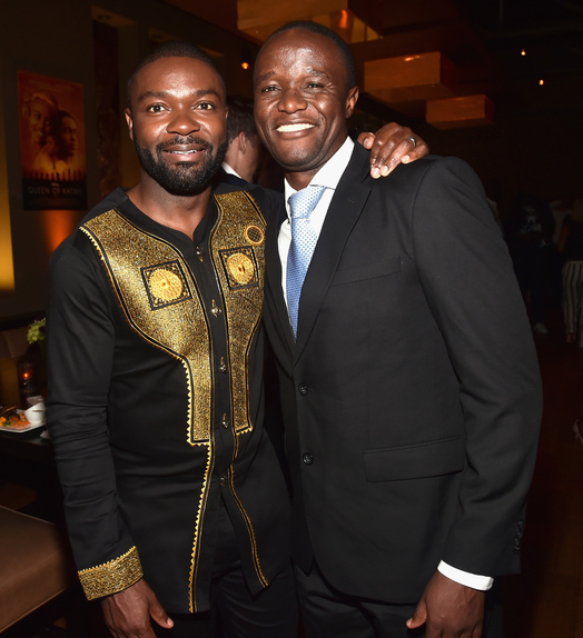 "Actor David Oyelowo (L) and Chess Coach and Director of Sports Outreach in Uganda, Robert Katende at the world premiere of Disney's ""Queen of Katwe"" at Roy Thompson Hall"